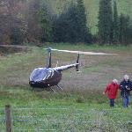 Guests arriving back from a helicopter ride over the fantastic lakeland scenery