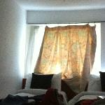 tiny grubby curtain not doing its job!