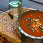 half corn & shrimp panini with red pepper soup w/lovely feta cheese. Presented like a work of ar