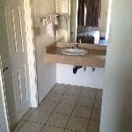 Granite Vanity in All rooms with Tiled floors