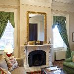 One of our Grand Suites with original hand carved Italian marble fireplace.