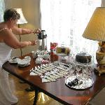Guest prepares coffee and cake