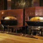 Our twin stone fired ovens in the open kitchen