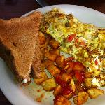 cajun omelette with potatoes and wheat toast