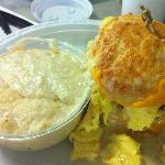 Fried Chicken breast, egg and cheese biscuit with jalapeno cheese grits
