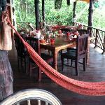 Veranda dining area/lounge with ocean & garden view
