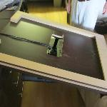 Fallen flat screen TV and mounted particle board.