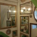 mirrors on a hall's walls