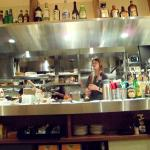 Open kitchen with funny young chef