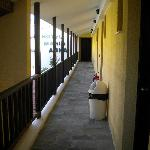 The second floor external corridor leading to the rooms