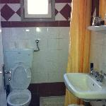 The bathroom - toilet, sink, shower stall, with heated floor in Greece!