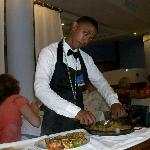 Being served dinner.