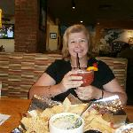 Pat enjoying a Hurricane and a appetizer before dinner.