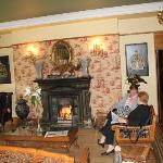 A cosy lounge with lovely log fire on a cold day.