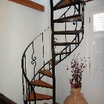 The spiral stairs that will take u up to the double bed