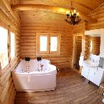 Bathroom with Jacuzzi at the Bungalow