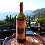 Dinas Paradise wine with Agios Gordios bay in background