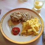 scrambled eggs with sausage gravy biscuits for breakfast