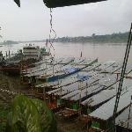 The Mekong River boats just below the hotel.
