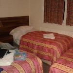 Three beds crammed into one room