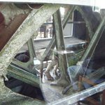 the mill's waterwheel still turns behind glass in the bar