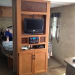 swivel tv with tv on one side and mirror on the other