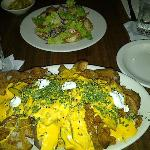 my daughters salad just beyond the nachos there, the Nachos were $14