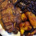 Beef short ribs with rice and beans and plantains