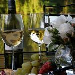 Relax with a glass of wine on the deck overlooking the pond