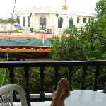 view from balcony of noisy fun fair