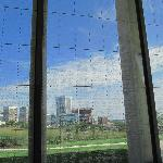 Skyline of Richmond seen through names etched into glass wall