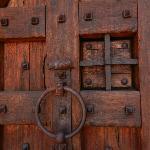 One of the beautiful handmade doors with ironwork.