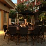 Outdoor patio table with fire pit