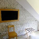Television with wood surround and pebbled wall