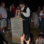 Alan Melanson with lantern on a gravestone.