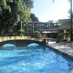 Pool area with a nice bridge