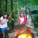 "View from our cabin and kids enjoying toating marshmallows with their ""Moosemallow sticks."""