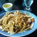 Yakisoba noodles with chicken and a cup of green tea