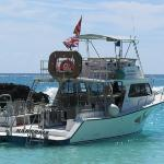 Dive boat anchored at the private beach