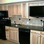 Complete kitchens with granite countertops, tumbled marble back splash, in-room ice maker...