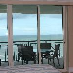 view from 912 master bedroom to balcony table & ocean
