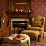 Snuggle up and relax next to the fireplace in room 2 at Berry Manor Inn