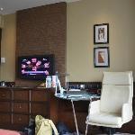 TV, desk, minibar is under the TV