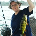 Vickie one of her first fish caught ever, Lake Garun