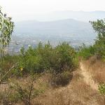 The single track ahead, with Oaxaca Valley in the distance
