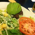 Bun-less burger and half an avocado
