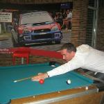 Not easy playing pool when you are about to be hit by a rally car!