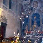 Seethrough cross above main altar.Contains Chalice,Staff,patern and relic of St Mang
