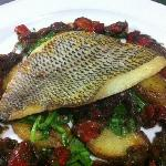 Fillet of seabass, sauteed potatoes & rocket with red pepper, caper & caramelised onion vinaigre