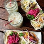 Chilled horchata and mixed tacos